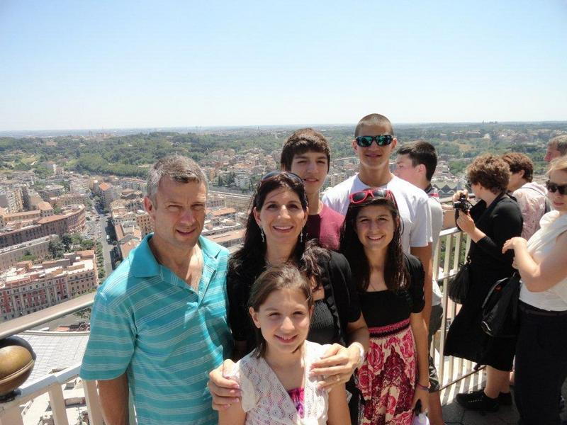 hintze family standing on topof st. peters cathedral vatican city rome.jpg