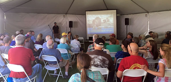 Audience looking on as Chris Servheen gives presentation on grizzly bear recovery