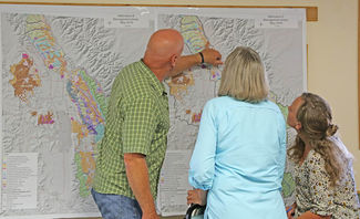 Those who attended the Open House had the opportunity to ask questions, express concerns and study the maps for the different management alternatives presented in the Flathead National Forest Draft Forest Plan. Image: ANDI BOURNE/Pathfinder