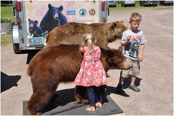 Interested young participants checking out one of the many displays at the Bear Fair