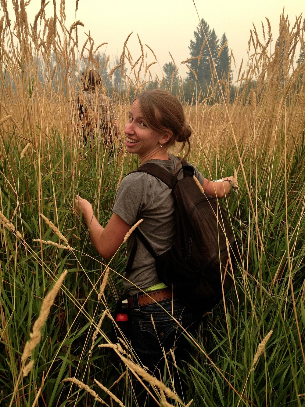 Anna wading through the reed canary grass on our way to the river for the first day of Watershed Dynamics