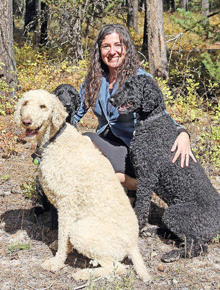 Swan Valley Connections new Executive Director Rebecca Ramsey with her three standard poodles, Owen, Evora and Juice. IMAGE: Andi Bourne/Pathfinder