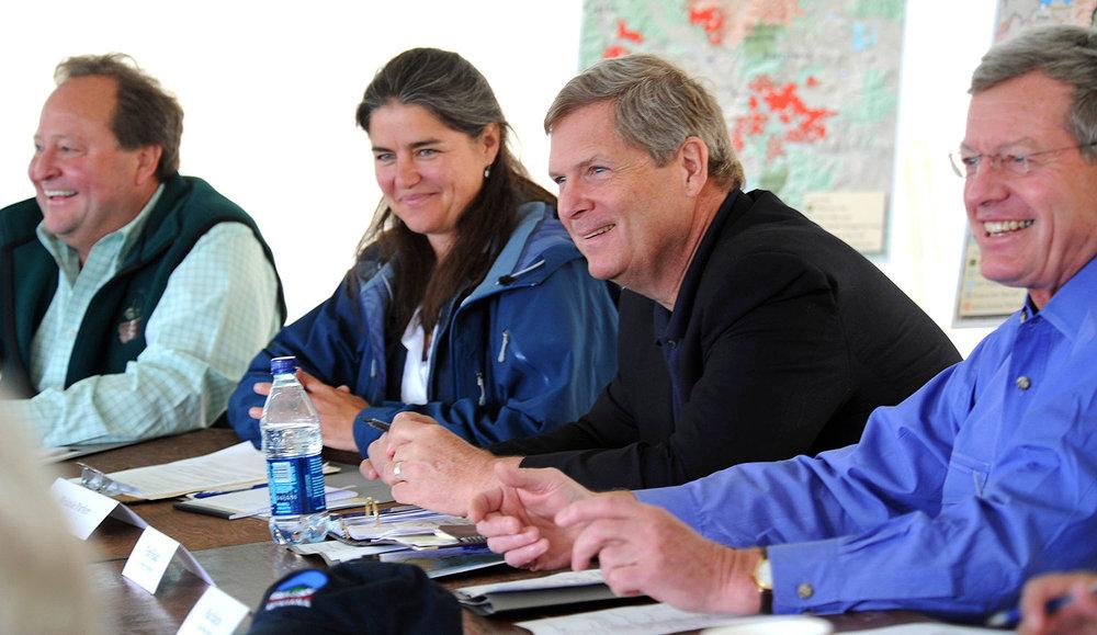 L to R: Former MT Governor Brian Schweitzer, Melanie Parker, former USDA Secretary Tom Vilsak, former US Senator Max Baucus. PIC by Eliza Wiley/Helena Independent Record