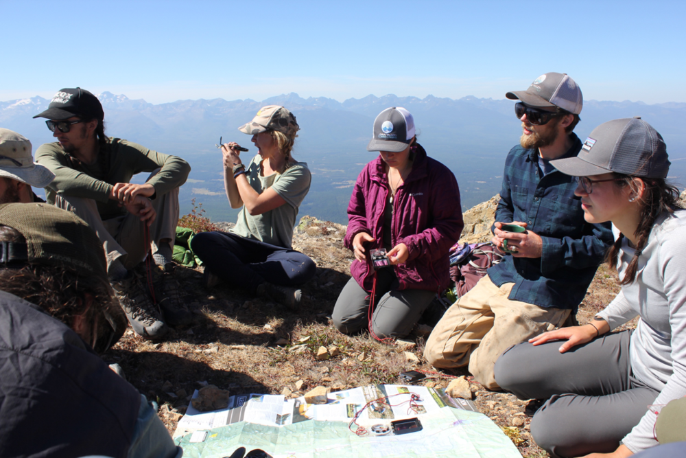 Practicing map and compass skills at Holland Lookout.     Photos by Meredith Fraser