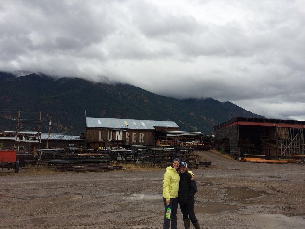 L&L students Izzy and Sarah pose in front of the RBM Lumber saw mill.  Photo by Meredith Fraser.
