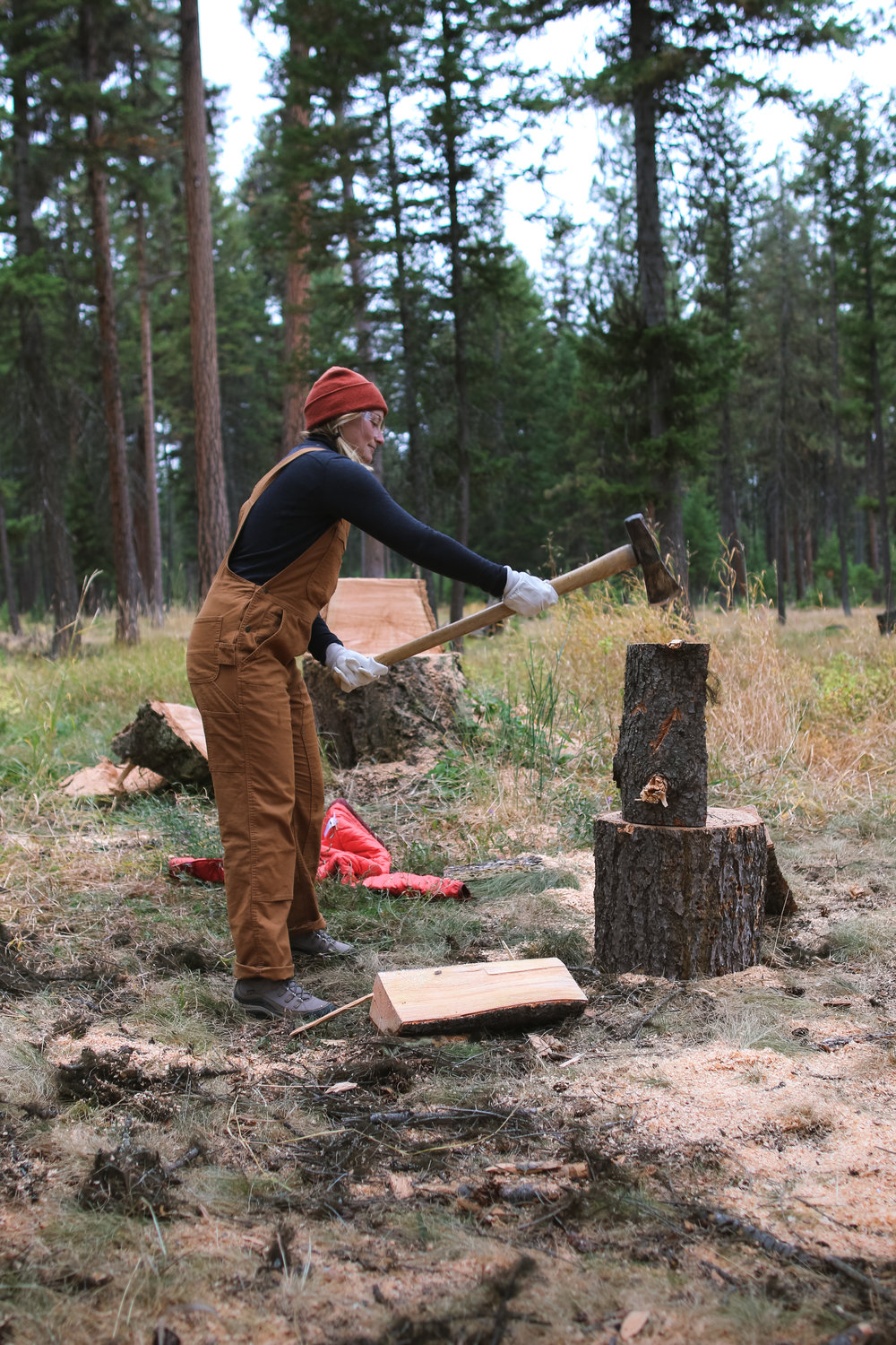 L&L student Izzy Mason chopping firewood at Community Firewood Day.  Photo by Andrea DiNino