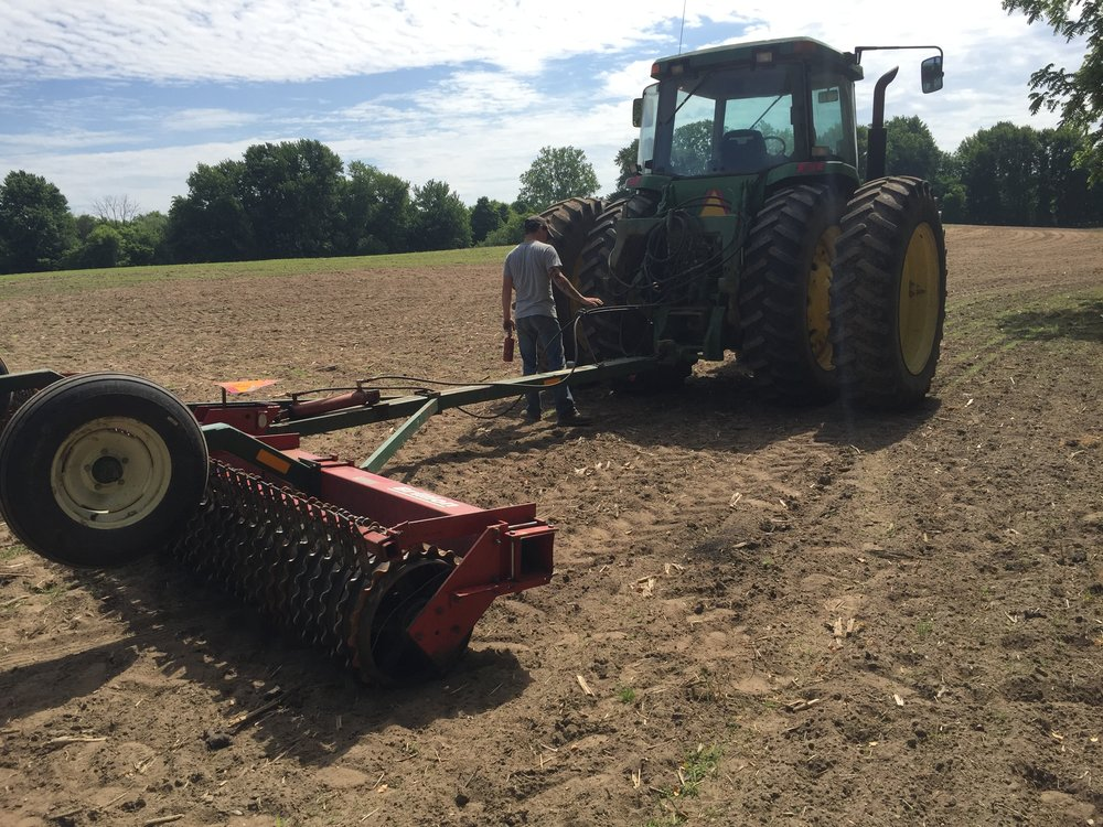 Hooking up the cultipacker.  We ran it over the field again after we spread all the seeds.   We did it just to drive them just a bit into the ground so that they didn't blow away.