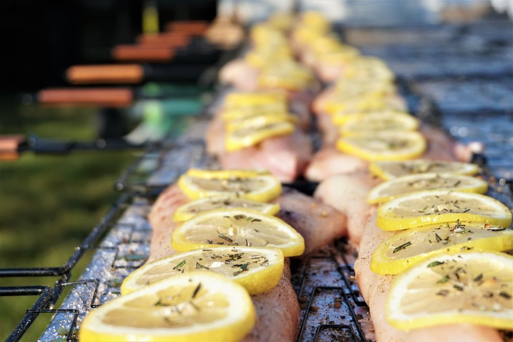 William Ference Catering striped bass on charcoal grill