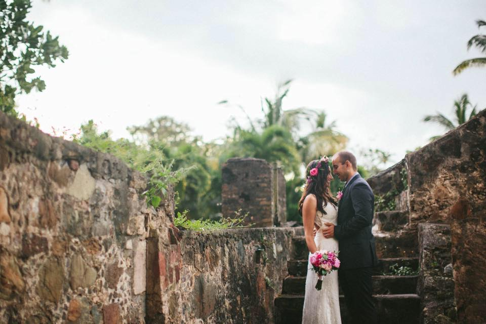 Gorgeous wedding in the Caneel Bay ruins with flowers designed by Jessica Aubain of Roses Too.  Photo by Savanah Loftus photography.