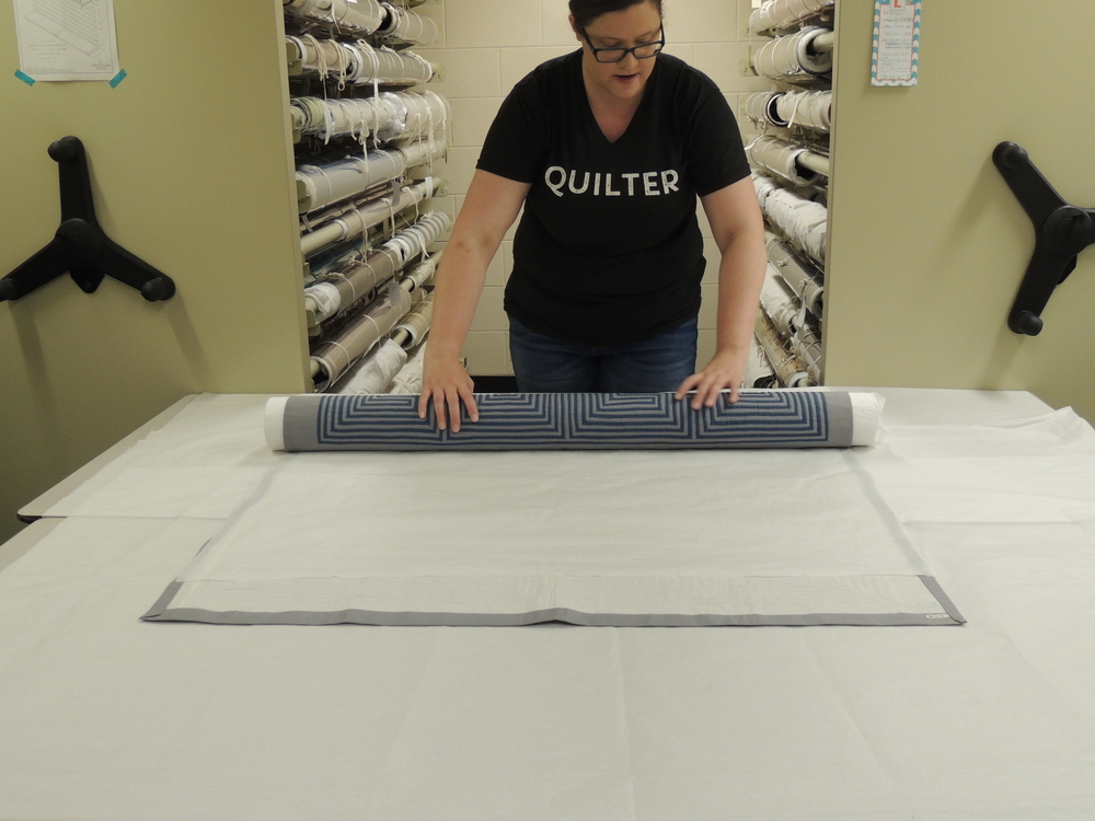 Begin slowly rolling your textile, making sure the edges stay even on both sides