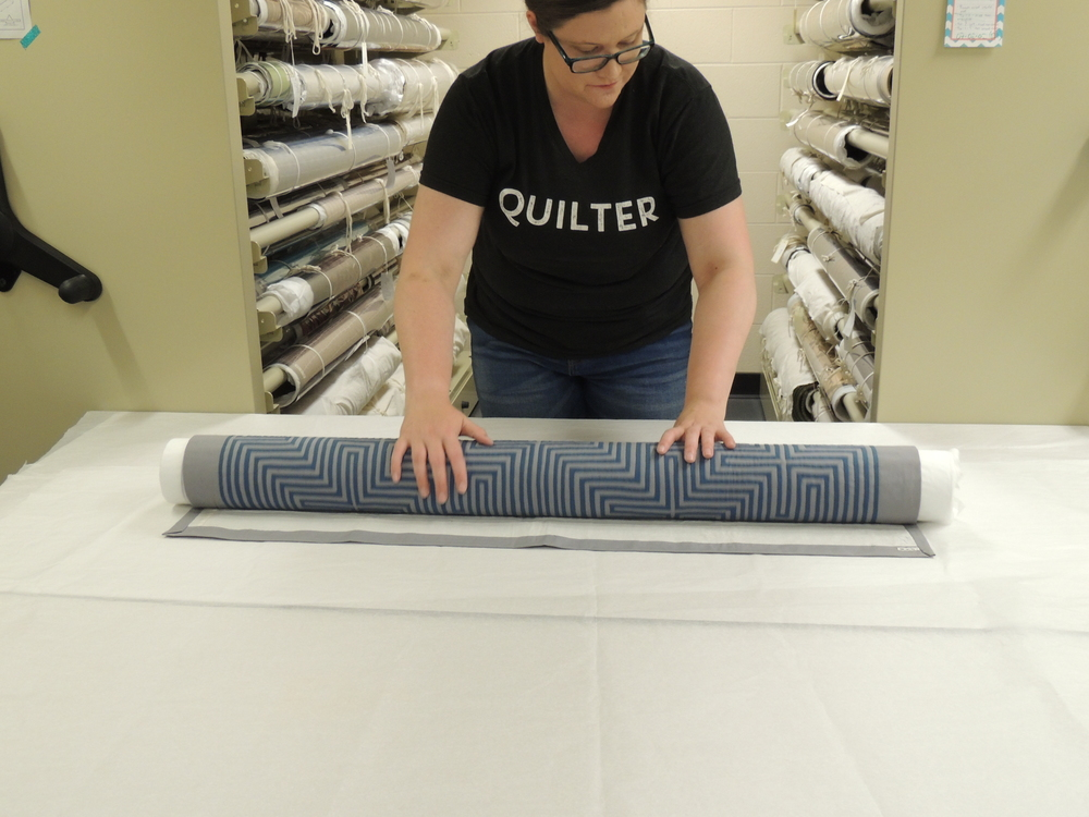 Roll your textile entirely onto the tube, making sure there are no creases or lumps
