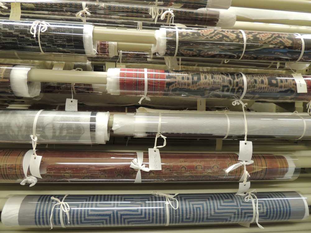 Rolled textiles must be suspended on a hanging pole system to ensure they will not sag or crease