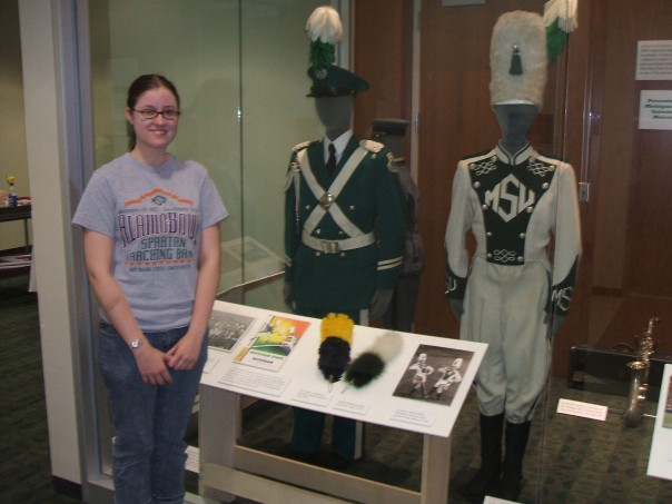 Me almost TWELVE YEARS ago with a marching band exhibit I assisted with as an undergrad at the MSU Museum.
