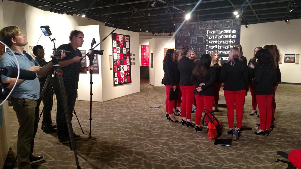 NIU's all-female a cappella group The Harmelodics warm up before their performace