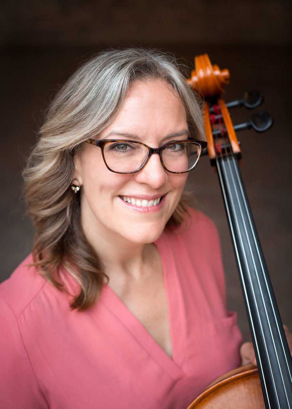 Melissa Bach, Cellist Client Liaison, Founding Member  DePaul University School of Music  If you work with Quartet Parapluie, you'll likely collaborate with Melissa on some level. As a founding member and client liaison, she plays a role in just about every aspect of Quartet Parapluie, whether performing on stage, or taking care of business details. Her clients are pretty much crazy about her – just read about it on  Yelp  or  The Knot . Plus, she's a highly sought-after cellist. You can catch Melissa performing live around Chicago on a regular basis, with New Philharmonic, Illinois Philharmonic Orchestra, Chicago Jazz Philharmonic, or Northwest Indiana Symphony. She's performed live with artists such as Idina Menzel, Peter Gabriel, Michael Bublé, Barry Manilow and Kanye West. Plus, she's appeared on the Late Show with David Letterman, as well as the Oprah Show. In the world of Indie-Rock, she has performed with Bright Eyes, Kishi Bashi, Pinetop Seven, Rilo Kiley and a host of other Chicago bands, including Sleeping At Last, which featured her in a  music video .  Melissa's teachers have included Christopher Costanza and Robert Jamieson.