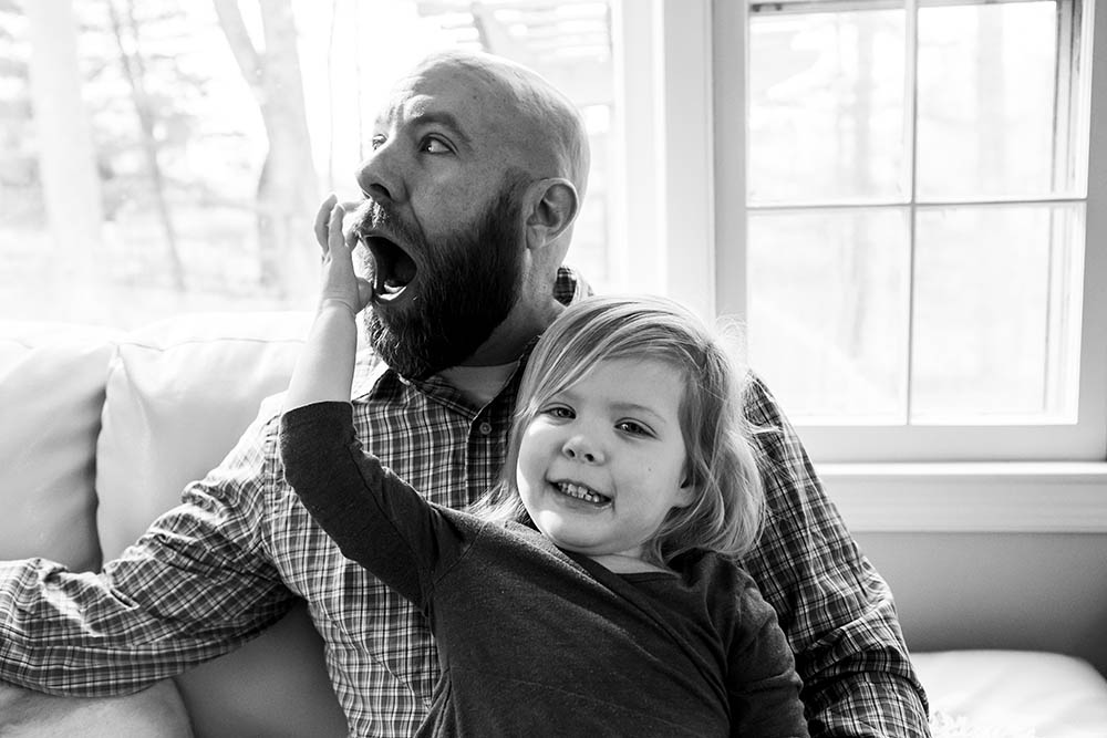 Father and Daughter play in front of a Connecticut window
