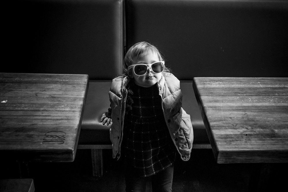 Candid toddler portrait at shake shack in New Haven, connecticut.