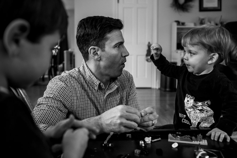 Candid portrait of CT father and son in black and white.
