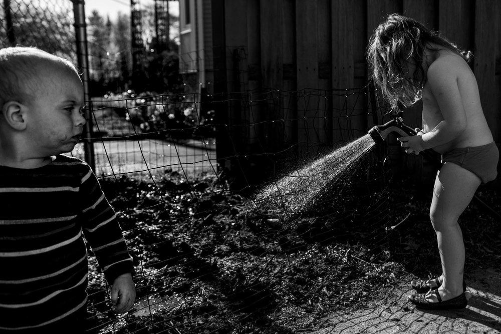 fine art black and white child portraiture in a boston backyard