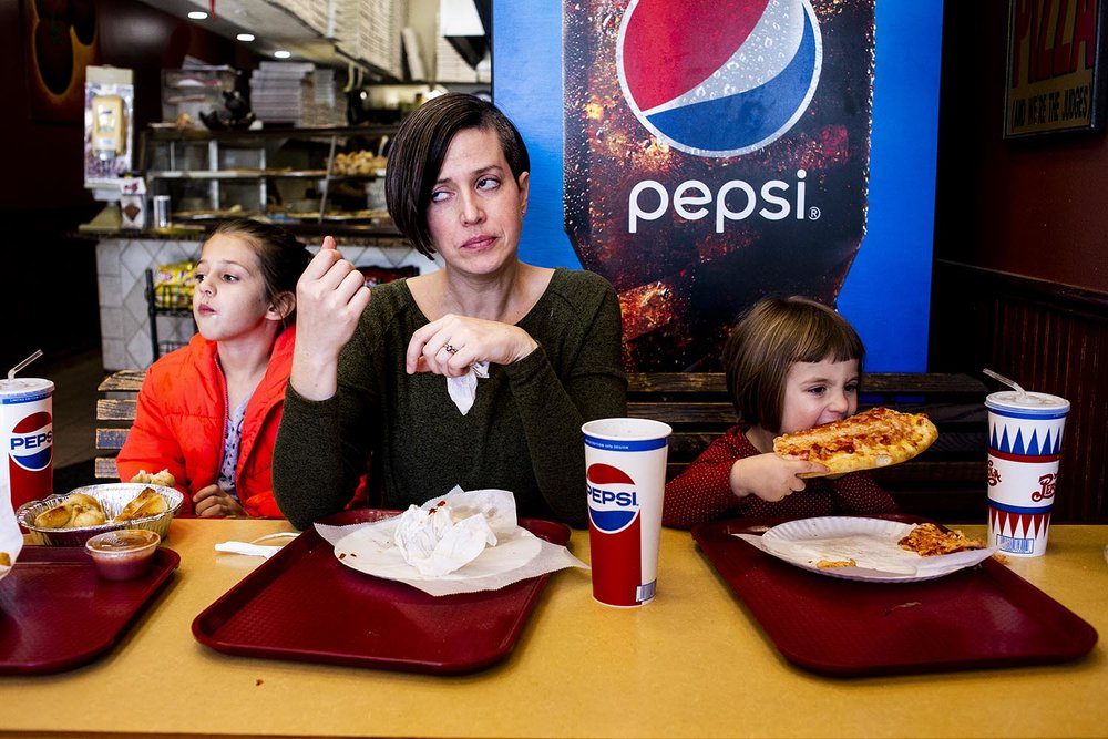 perfect picture of momlife because she's rolling her eyes at her kids in a boston pizza parlor