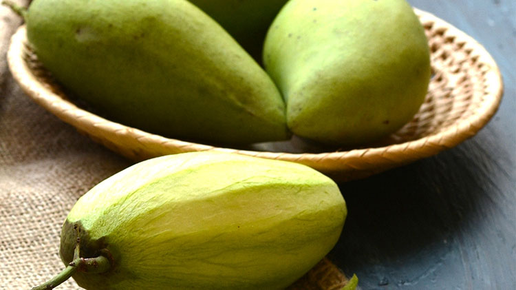 Above photo:  Green Mangos are both sour and sweet. With a much firmer texture than a ripe mango, they're great for salads and pickling.