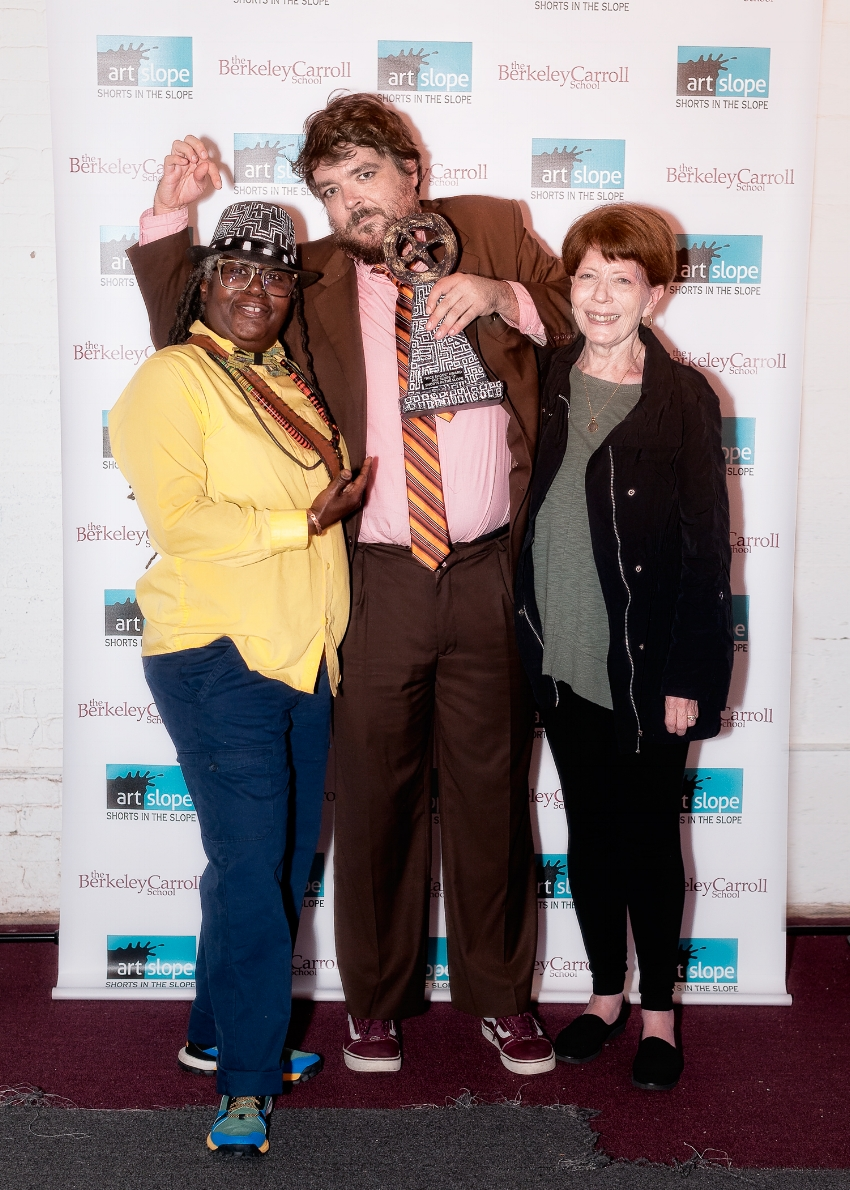 Director Liam Parry holding his 'Nice Shoes' award trophy with his mother, Maureen,and trophy designer and master of ceremonies, Myra Kooy. Photo:©2017 Gabriele Holtermann-Gorden-ghgPhoto