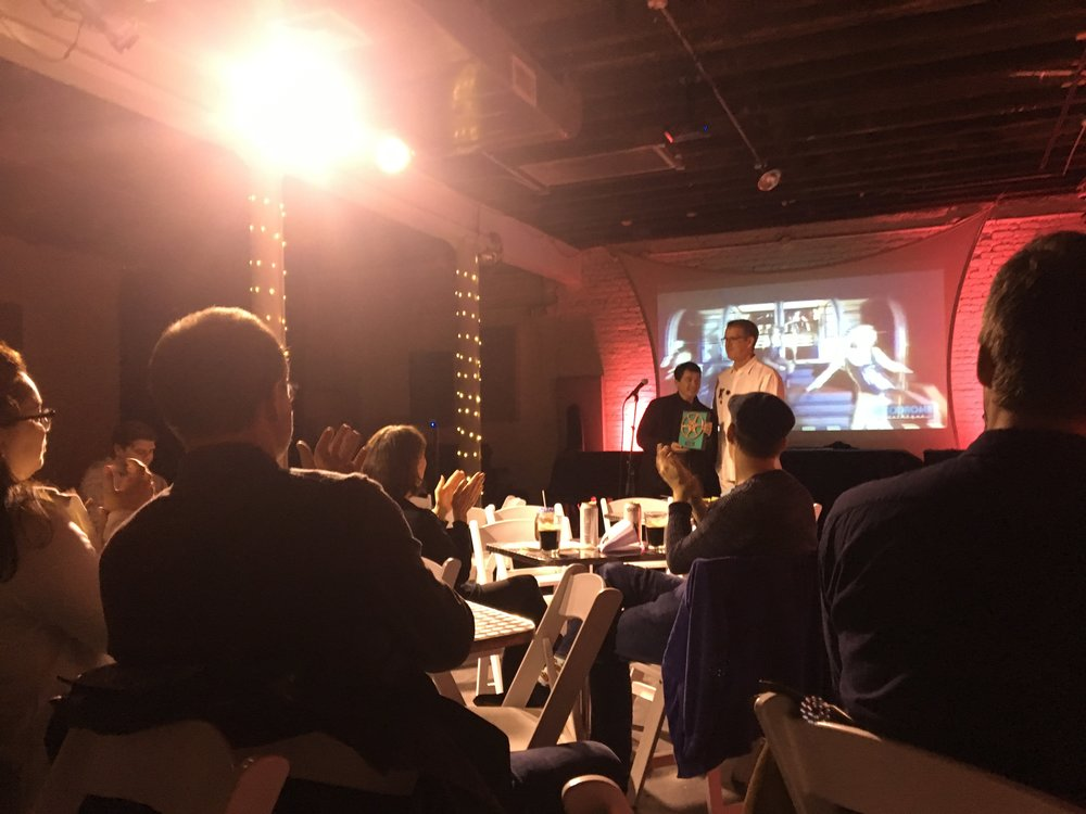 """After Party and Awards Ceremony at ShapeShifter Lab, April 7, 2019. Emcee John Mazurek presents Christopher Ming Ryan with award for Best Documentary Short for """"Philip Carlson - On Behalf of Talent'."""