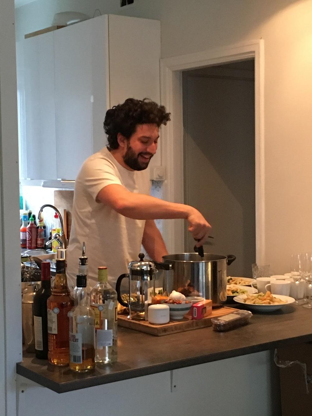 """Here's Nick serving the """"cheap ass vegan"""" dinner."""