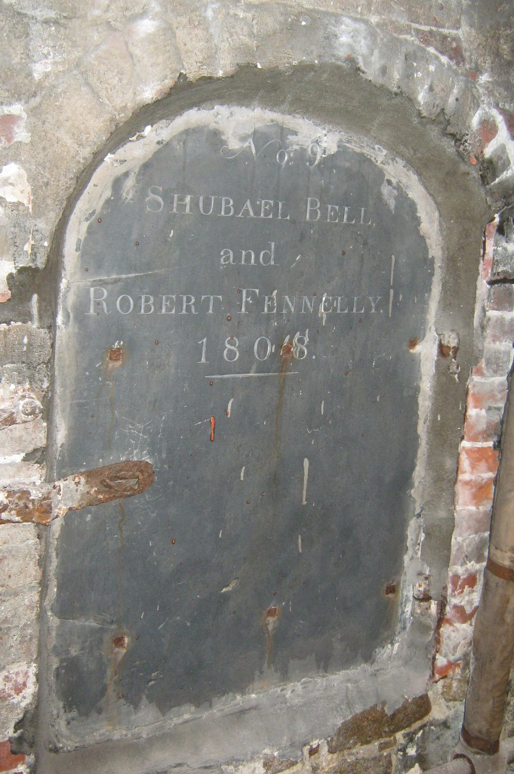 Tomb 9, under the front door of the church.