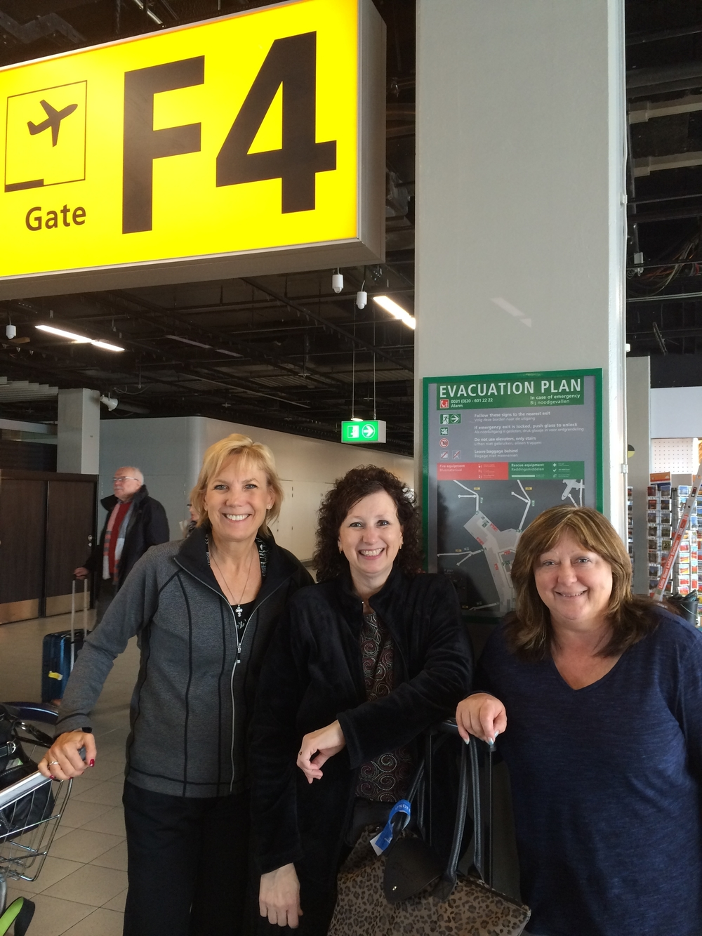 Chosen Women team (l to r) Sheryl, Marnie Swedberg (Warroad, MI) and Sharon Hurkens (Long Island, NY) meet in person for the first time in Amsterdam at the boarding gate to Nairobi. It truly was the dream team!
