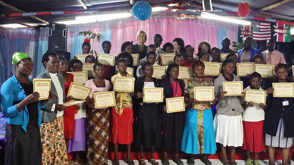 Women's Business Conference attendees in Nairobi, Kenya are proud to show their certificates of achievement for completing the conference.