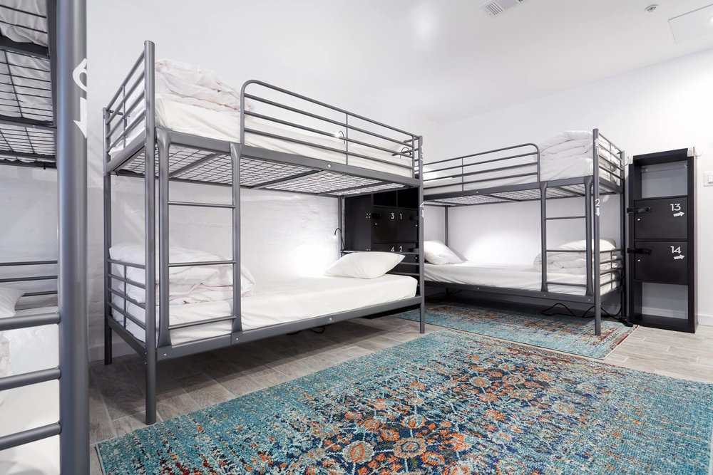 View of Guest Shared Room showing clean bunk beds, lockers, and the room