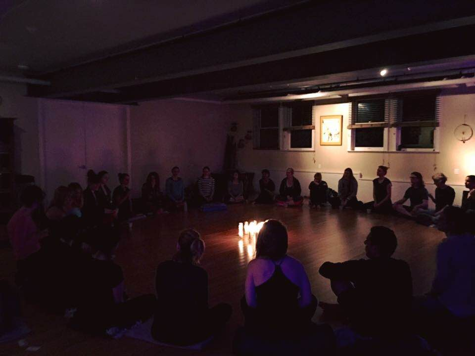 Chanting mantra by candlelight on Saturday.