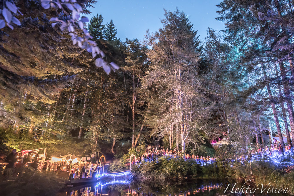 "Beloved attendees gather around the ""Secret Lake"" Friday night to thank the waters"