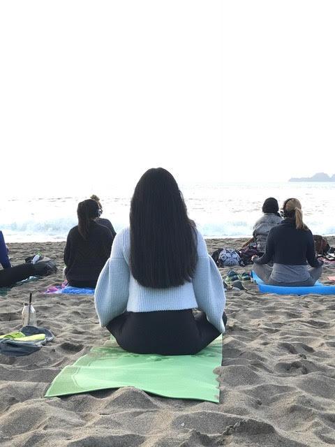 yoga student breathes in ocean air on bakers beach.jpg