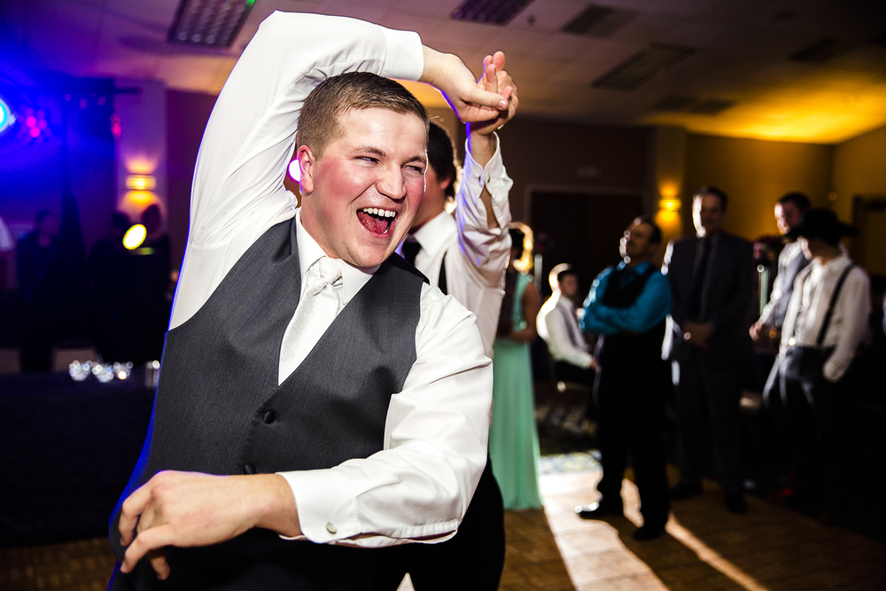 groom, dancing, wedding reception, a little to drink, having fun