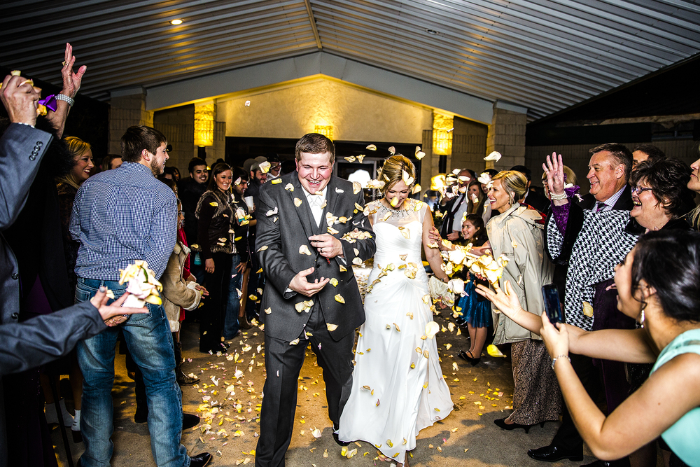 grand exit, lubbock wedding photographers, dramatic, sweet, flower pedals, honeymoon