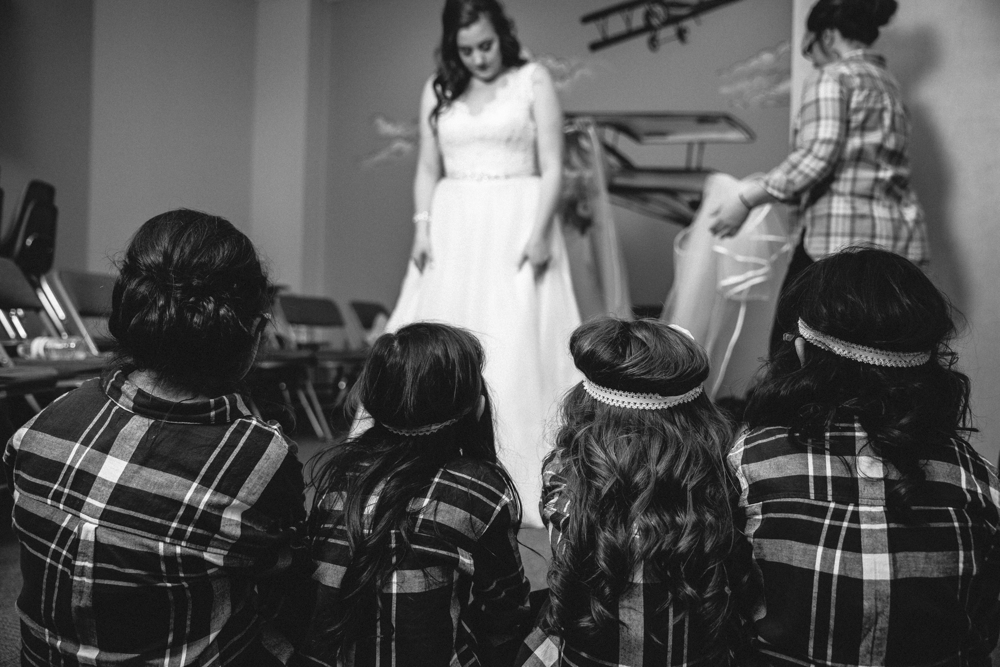 daughters looking at mom in her wedding dress, sweet moment, getting ready for your wedding