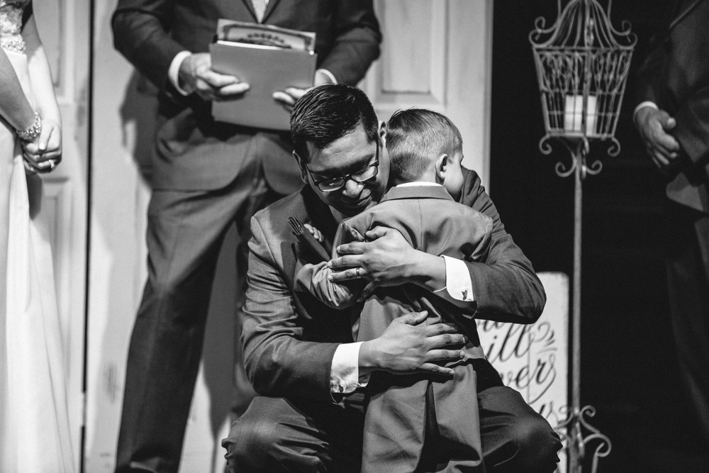 father and son, sweet moment during wedding ceremony, experience life church lubbock texas