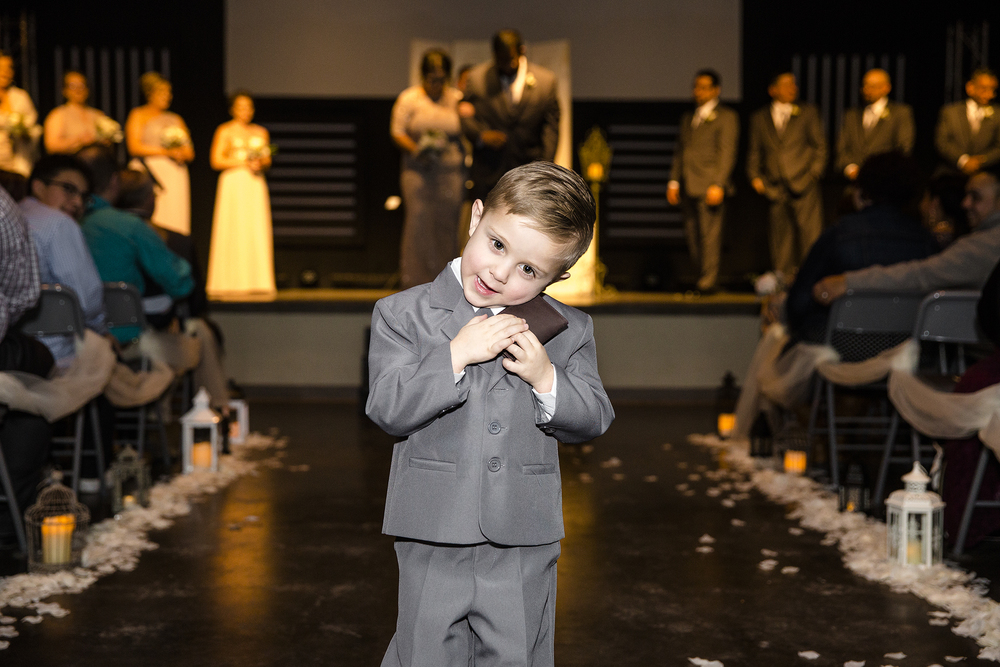 ring bearer holding his gift, cute moment, wedding ceremony
