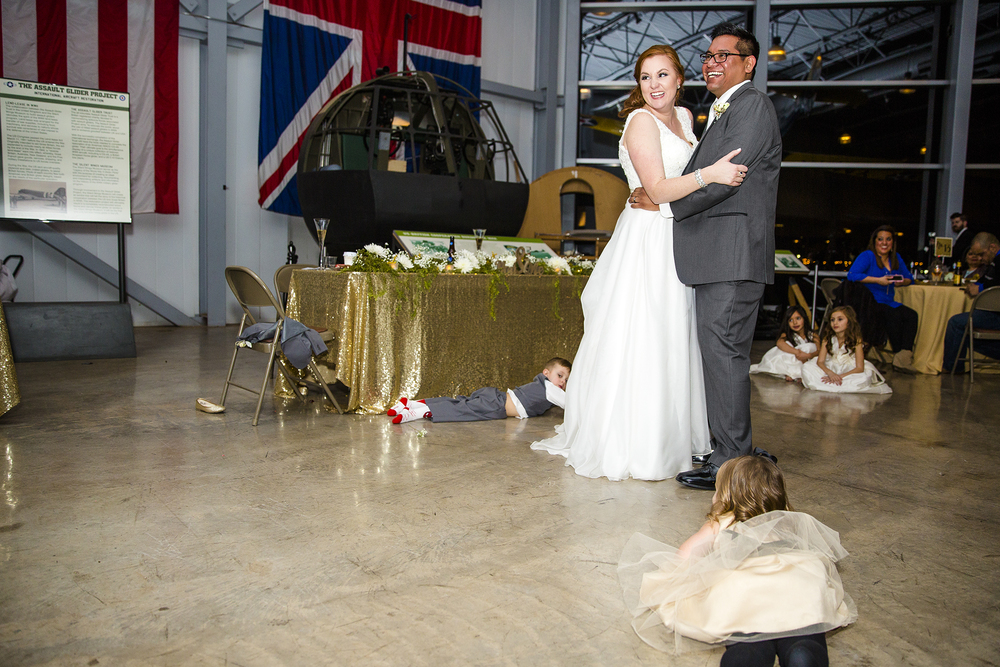 first dance, bride and groom, wedding reception, silent wings museum, giant windows