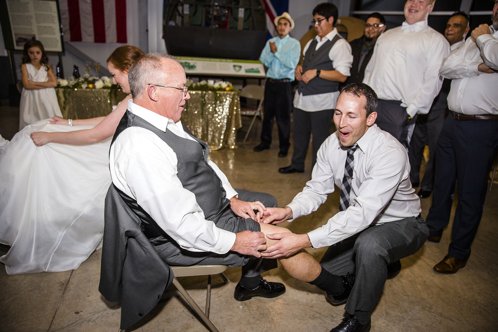 the other garter toss, father of the bride, brother in law, funny moments, fun wedding reception