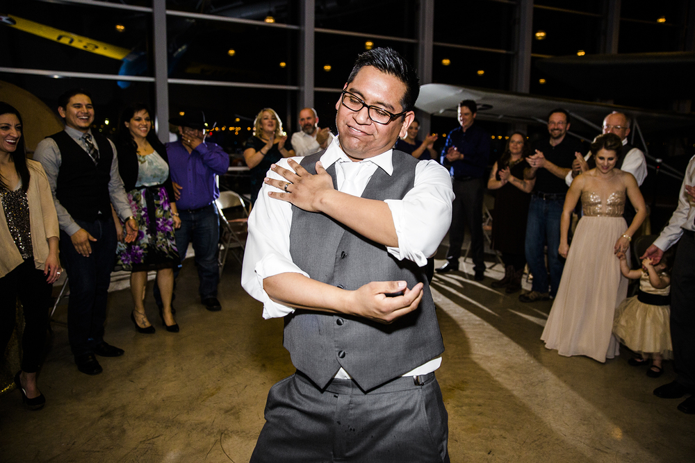 groom, dancing, exciting and fun wedding reception, wedding photography, lubbock silent wings museum