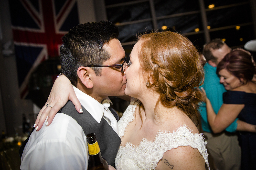 bride and groom kiss, wedding reception, romantic, fun wedding reception