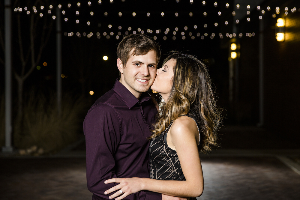 kissing, romantic, sweet engagement photos, soft light, downtown Lubbock, LHUCA building, bokeh