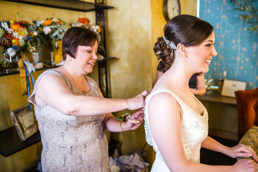 Bride getting ready, putting on the dress