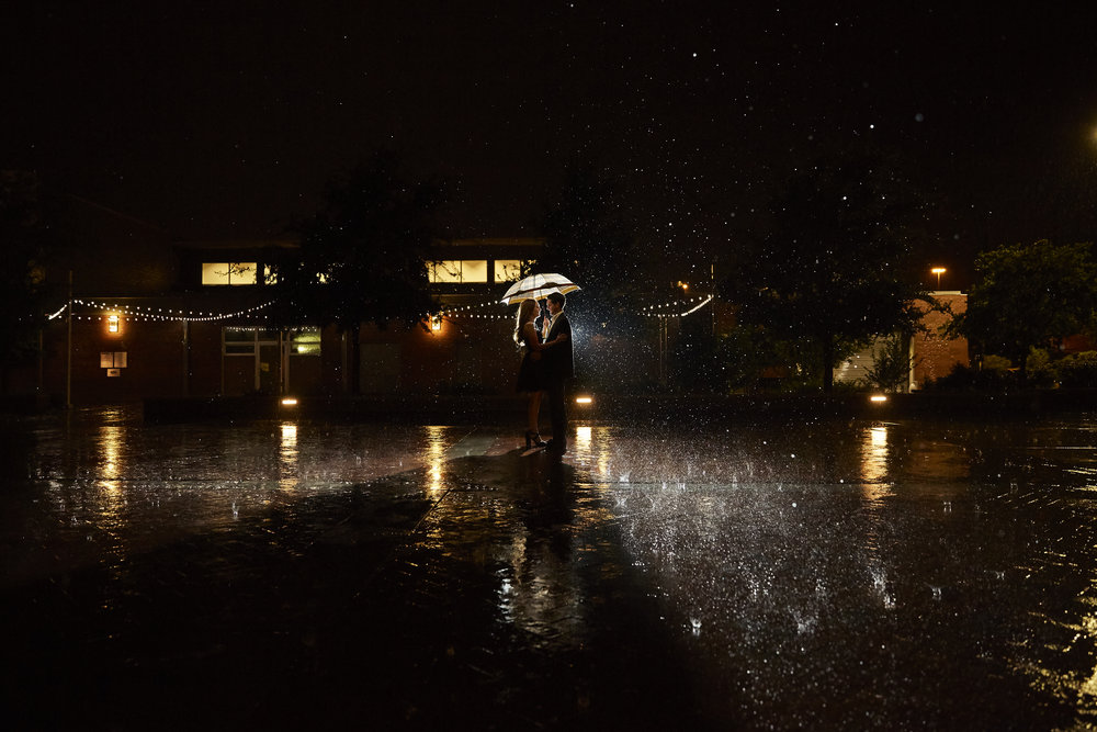 Lubbock wedding photographer, rain pictures, umbrella, reflection, beautiful light, night photography