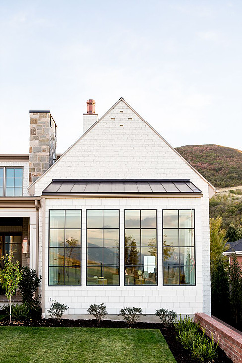 A lovely example by Hyrum McKay Bates Design, revealing that the use of steel coated roofing is as equally charming as copper roofing and more cost effective