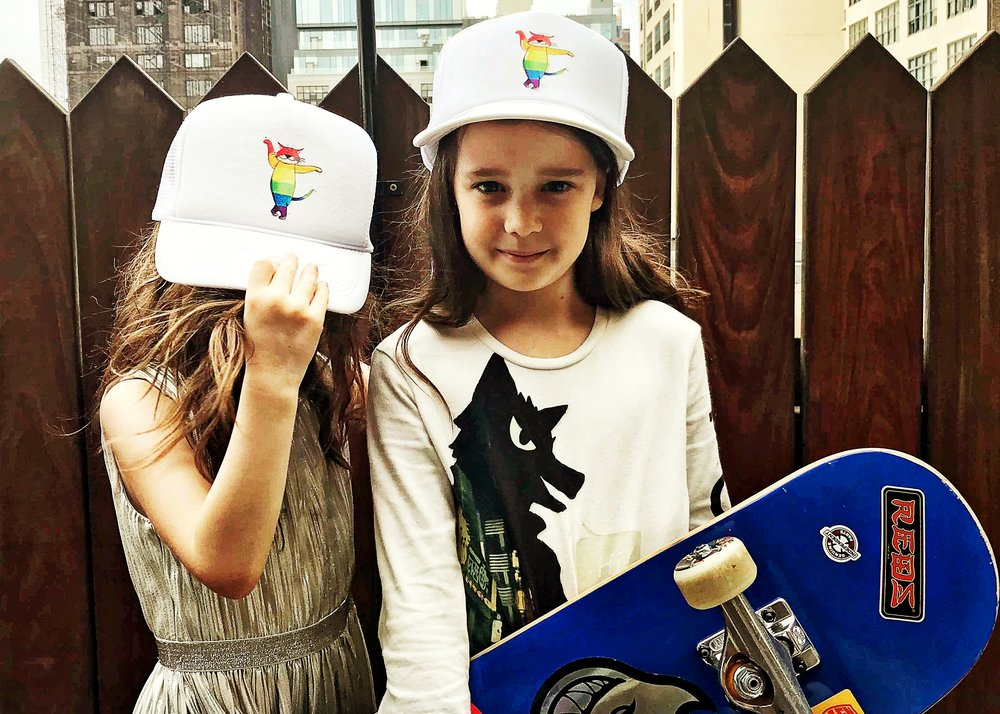 Zoë & Stella Bellebeau (NYC) love their Purrride trucker hat.  Photo: Arthur Bellebeau