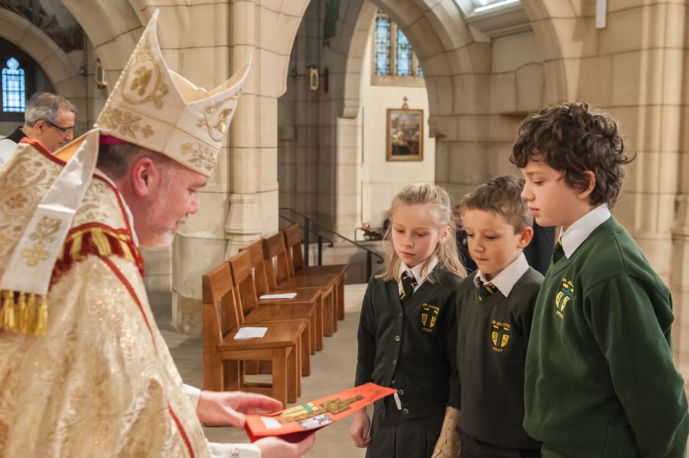 Presenting our school's card to Bishop Marcus